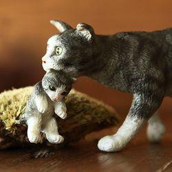 새끼 운반하는 고양이