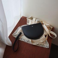 Rma. Half moon clutch bag