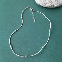CURVED PIPE BALL CHOKER